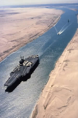 Aircraft carrier traveling through the Suez Canal