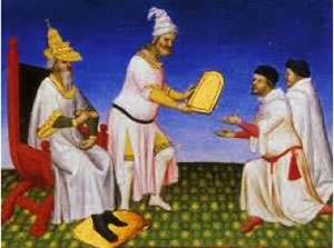 Kublai Khan presents the Polos with a golden tablet.