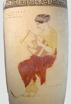 A Greek vase depicting a woman playing the lyre.