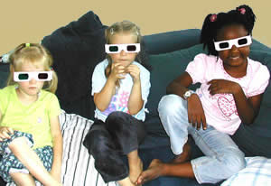 Children wearing stereoscopic glasses.